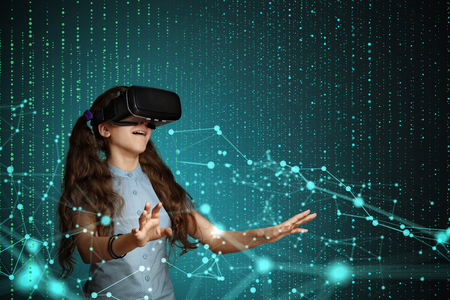 Young girl using virtual reality glasses. Future technology concept. Reklamní fotografie - 74509833