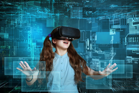 Young girl using virtual reality glasses. Future technology concept.