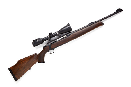 Hunting rifle with optical sight isolated on white background.