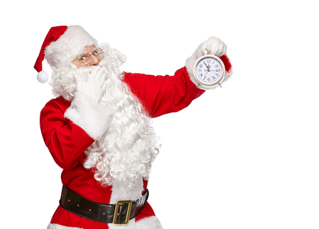 Santa Claus points finger at the clock. Christmas concept. Isolated on white background.