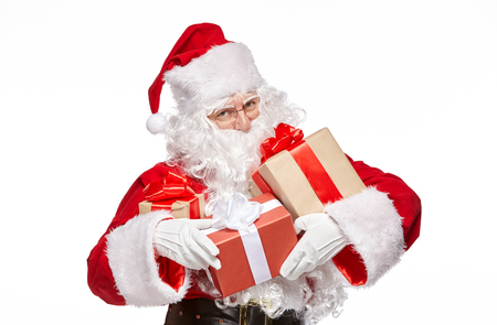 Happy Santa Claus is holding presents. Isolate on white background.