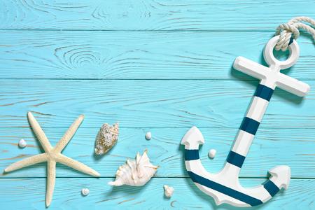 Marine accessories on a blue board. Summer time sea vacation concept. Place for your text. Stock Photo