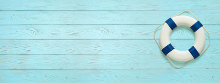 Sea lifebuoy on blue wooden background . Copy space for individual text. Summer Banner.