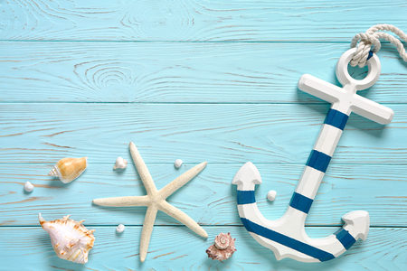 Marine accessories on a blue board. Summer time sea vacation concept. Place for your text.