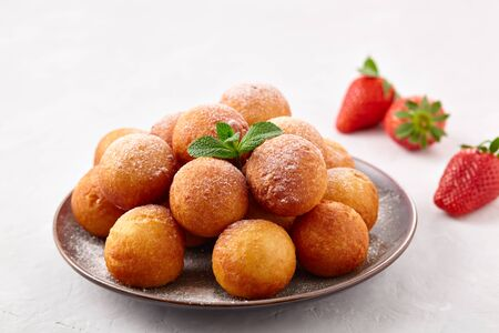 Beautiful breakfast. Cottage cheese donuts  balls  on a light background. 스톡 콘텐츠