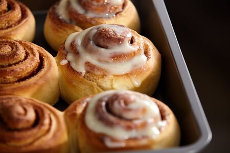 Fresh bakery. Cinnamon rolls are oiled. Homemade cinnabon close up.