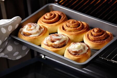 Fresh bakery. Cinnamon rolls are oiled. Homemade cinnabon.