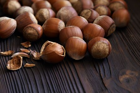 Hazelnuts close-up on a dark wooden background. 스톡 콘텐츠