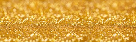 Golden giltter texture christmas abstract background. Gold bokeh abstract background.