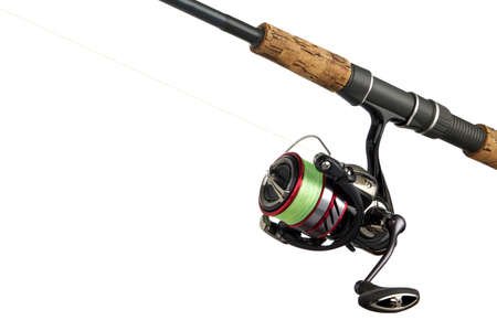 Fishing tackle isolated on white. Spinning reel close up.