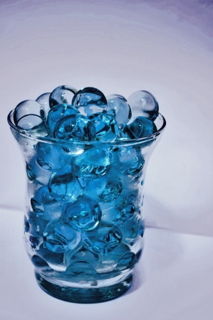 bird view: darkblue transparent waterballs in a cup of glass in bird view