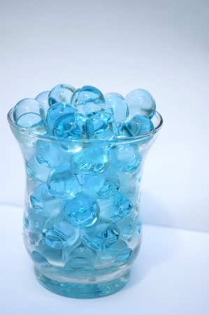 bird view: turquoise transparent waterballs in a cup of glass in bird view