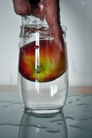 repress: apple in a glass of water Stock Photo