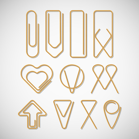 Gold paper clips different paper clips collection isolated on white background