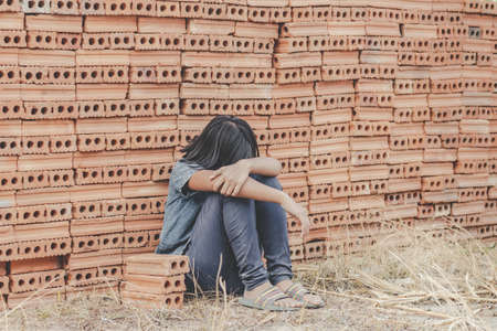 traumatized children concept. Child working in a brick factory. world day against child labour concept