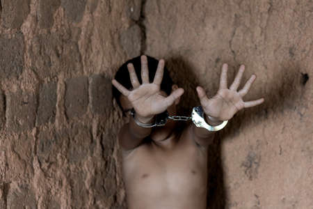 little boy with shackle. Abused and tortured concept. Human trafficking concept.