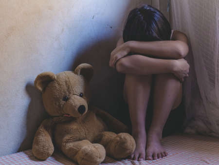 Violence and rape concept,concept photo of sexual assault,traumatized young girl