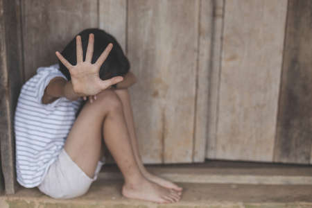 kidnapping children sitting in old earth brick wall,children violence and abused concept,human trafficking concept