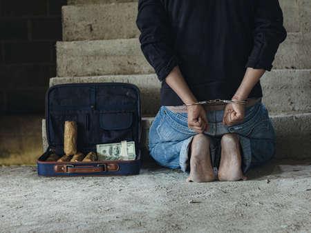 Police arrest drug trafficker with handcuffs.Drug traffickers were arrested along with their heroin.
