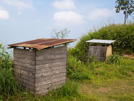 toilet in rural area build from wood board photo
