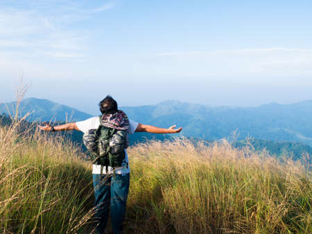 Asian man enjoy the freedom in valley Stock Photo - 26493971