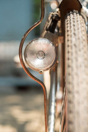 dynamo: light of bicycle vintage style, using spinning of wheel to operate.