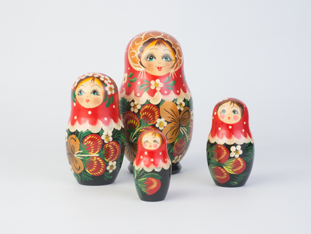 table top: Travel around the world for your colorful life .Enjoy the funny trip journey .Top view for copy space some idea your create destination .object  cute  ,  Set of matrioshka dolls on white background.
