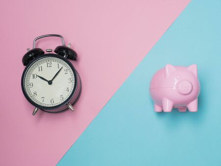 Piggy Bank Money Saving Finance Concept.Piggy bank pink color on color background.top view flat lay style. Stock Photo