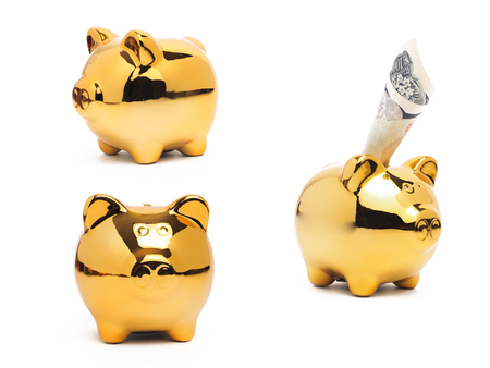 Piggy bank gold color and stack of money safe.Piggy Bank Money Saving Finance Concept Stock Photo
