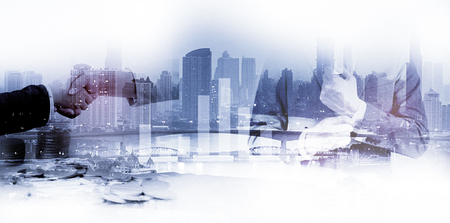 Double exposure of success business man city background.time for business.concept freedom business. Stock Photo