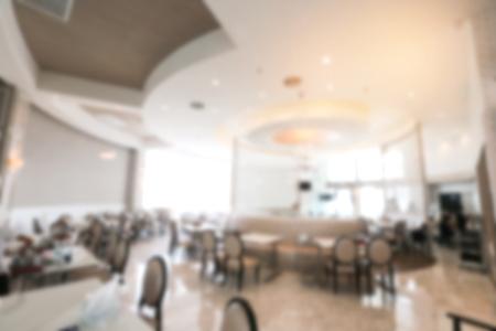 Abstract background luxury restaurant interior, blurred restaurant cafe, white interior vintage contemporary modern style. Stock Photo