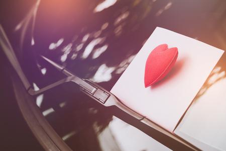 love letter heart on a sticky note under a windshield .vintage  color style