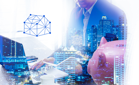 Business people calculating budget before signing real estate project contract .double exposure style house polygon line.shopping online marketing idea.