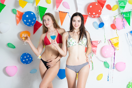 Sexy hot girl wearing bikini dancing party event new year or birthday.confetti happy and funny concept Stock Photo