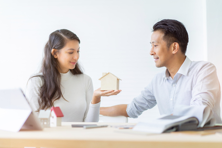 Happy couple plan buying house.Concept for Couple saving money for buy home and real estate. Select material for decorate furniture.