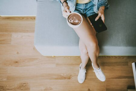 Attractive Asian woman drinking coffee.cheerful girl drinking coffee or tea.top view compose.