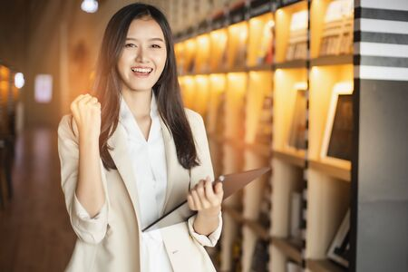 Smiling Asian business woman  looking at the camera  stay office.young Asian business executive happy.