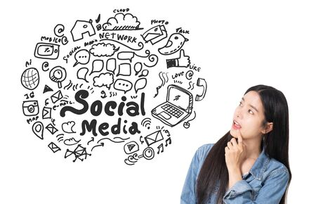 Asian young woman looking up of Hand drawn illustration of social media sign and symbol doodles icon. Stock fotó