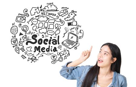 Asian young woman looking up of Hand drawn illustration of social media sign and symbol doodles icon. white background with a social media sketch.