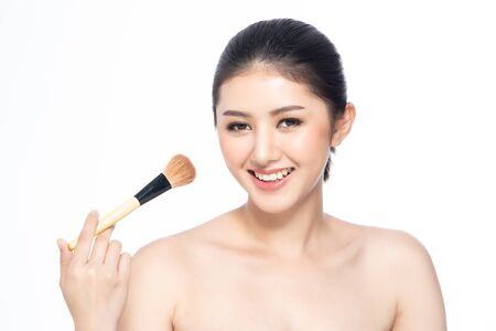 Beautiful Young Asian Woman short hair  with Clean Fresh Skin. Face care, Facial treatment, Cosmetology, beauty and healthy skin and cosmetic ideas concept.