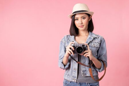 Tourist woman in summer casual clothes. Asian Smiling woman, Passenger traveling abroad to travel on pink background.She going to summer vacation. Travel trip funny.
