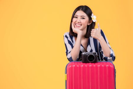 Tourist woman in summer casual clothes.Asian Smiling woman. Passenger traveling abroad to travel on yellow background. Asian woman going to summer vacation. Travel trip funny.