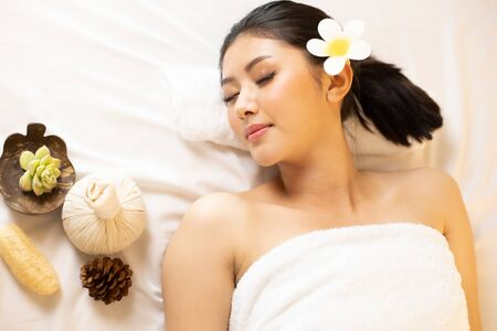 Asian Beautiful, young and healthy woman in spa salon. Massage treatment spa room  . Traditional medicine and healing concept. Stock fotó