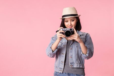 Tourist woman in summer casual clothes.Asian Smiling woman .Passenger traveling abroad to travel on pink background.Asian woman going to summer vacation.Travel trip funny.