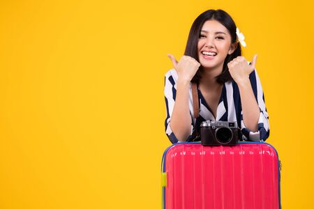 Tourist woman in summer casual clothes.Asian Smiling woman .Passenger traveling abroad to travel on colour background.Asian woman going to summer vacation.Travel trip funny.