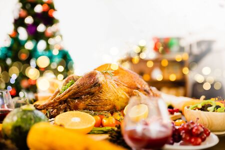 Roasted  chicken or turkey with sauce and grilled autumn vegetables: corn, pumpkin  on wooden table, top view, frame. Christmas or Thanksgiving Day food concept. Stock fotó