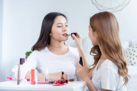 Portrait of young asian woman review giveaway gift product fan following channel, recording video make up lipstic cosmetic at home. Beauty blogger present beauty cosmetics Foto de archivo - 134648867