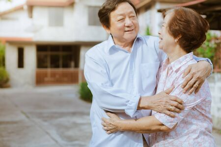 Happy elderly couple with lifestyle after retiree concept. Lovely asian seniors couple embracing together . Foto de archivo - 134712741