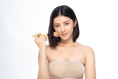 Beautiful Young Asian Woman short hair  with Clean Fresh Skin. Face care, Facial treatment, Cosmetology, beauty and healthy skin and cosmetic ideas concept. Foto de archivo - 135627903