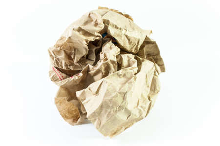 scrunched: Crumpled ball brown paper on isolated with white background.